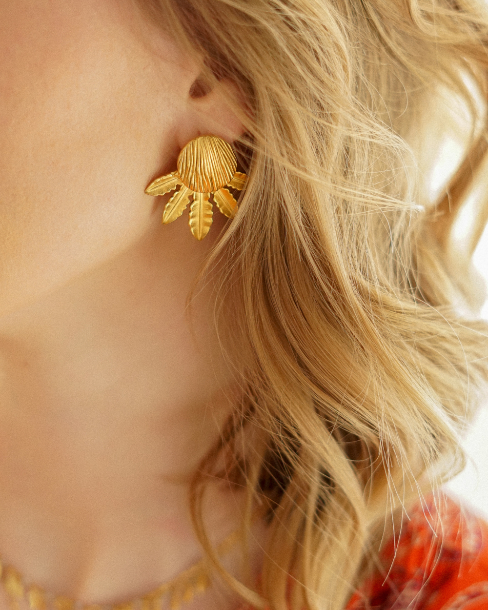 boules d'oreilles femme dorée